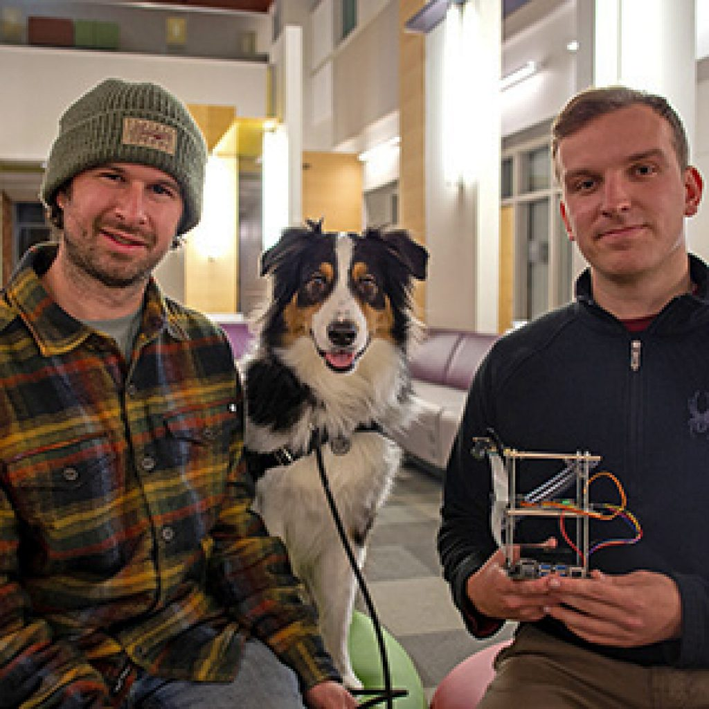 Phot of students Jason Stock and Tom Cavey with dog Henry
